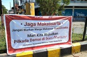 Jaga Makassar Ta', Spanduk Imbauan Pilwalkot Damai Bertebaran di Pinggir Jalan