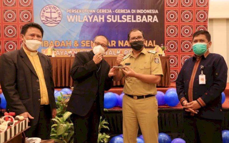 HUT PGI. Wali Kota Makassar, Moh Ramdhan Pomanto, saat hadir dalam HUT PGI Wilayah Sulselbara ke-71 di Hotel Max One Makassar, Selasa (25/5/2021). foto: humas pemkot makassar